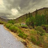 foto of dirt road  - Dirt Road in the Cantabrian Mountains Spain Vintage Style Toned Picture - JPG