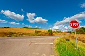 picture of intersection  - Road Stop Sign before the Intersection in Tuscany Italy - JPG