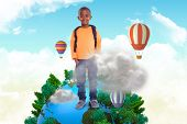 stock photo of pupils  - Cute elementary pupil smiling at camera against cloud computing graphic with hot air balloons - JPG