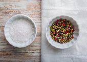 stock photo of salt-bowl  - Salt and pepper in white bowls - JPG