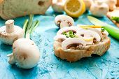 foto of green onion  - sandwich with fresh mushrooms mayonnaise and green onion on the board - JPG