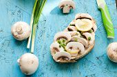 image of green onion  - sandwich with fresh mushrooms mayonnaise and green onion on the board - JPG
