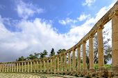 pic of oval  - View of the Oval Forum colonnade in ancient Jerash, Jordan - Jerash is the site of the ruins of the Greco-Roman city of Gerasa, one of the best preserved Roman cities in the Middle East.