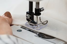 picture of stitches  - Close-up On Woman Stitching Cloth On Sewing Machine