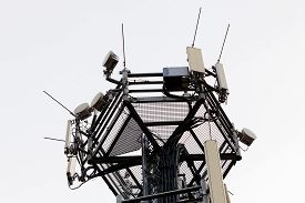 picture of telecommunications equipment  - telecommunication equipment on top of antenna tower - JPG