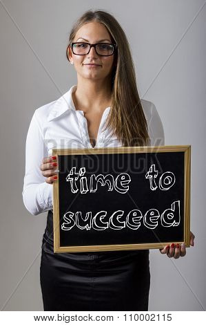Time To Succeed - Young Businesswoman Holding Chalkboard With Text