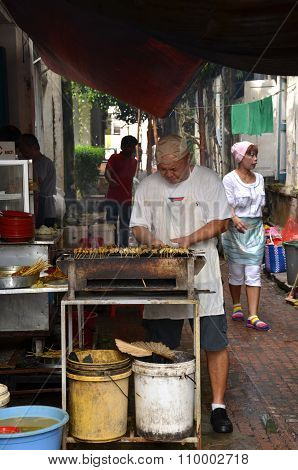A Unknown Hawker Prepares Stay On The Street In Ipoh, Malaysia