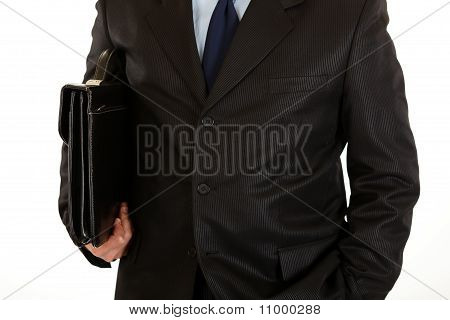 Businessman with briefcase in hand. Close-up.