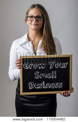 Grow Your Small Business - Young Businesswoman Holding Chalkboard With Text
