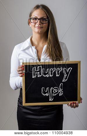 Hurry Up! - Young Businesswoman Holding Chalkboard With Text