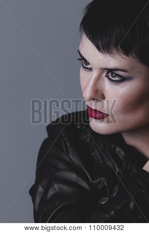lips, serious gesture girl dressed in black leather jacket