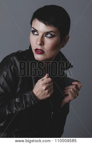 music star, serious gesture girl dressed in black leather jacket