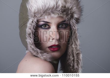 caucasian beautiful nude woman with furry winter hat girl cold