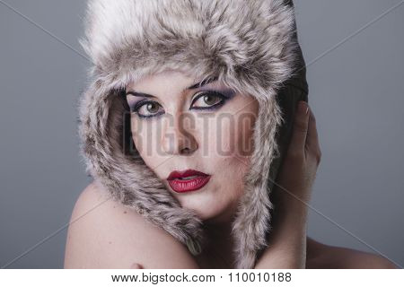 looking naked girl with Russian winter hat, cold