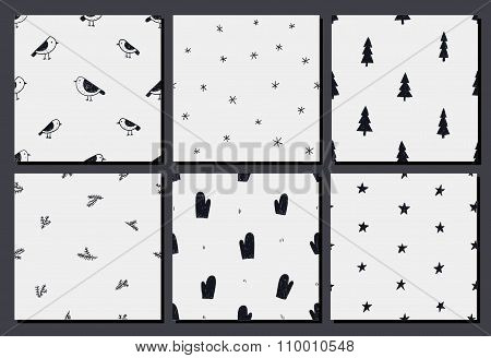 Vector set of hand drawn christmas, winter seamless patterns.