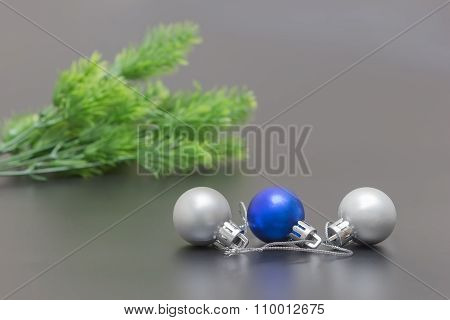 Three Christmas Ball And Spruce Branch