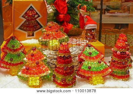 INNSBRUCK, AUSTRIA - DECEMBER 2014 : Display window of Gummy bears shaped to be different Christmas trees in Innsbruck, Austria on December 21, 2014. Gummy is a gelatin-based candy