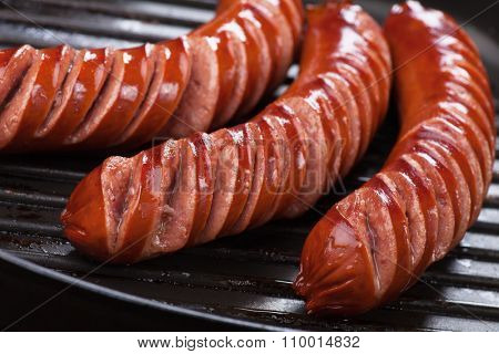 Grilled german sausages in grilling pan, close-up image