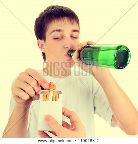 Teenager With A Beer And Cigarette