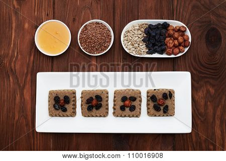 set of tasty vegan dessert and ingredients in white plates over wood background