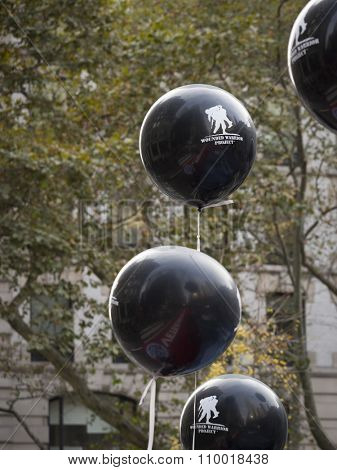 NEW YORK - NOV 25 2015: Black and white Wounded Warrior Project balloons that were held by vets marching the annual Americas Parade up 5th Avenue on Veterans Day in Manhattan.