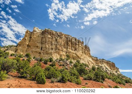 Yellow bluff and blue sky and clouds