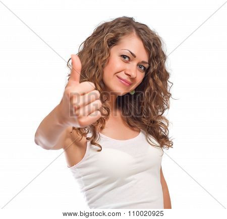 Curly young woman showing thumbs up gesture