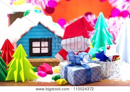 Santa Claus Paper And Small House In Snow Field