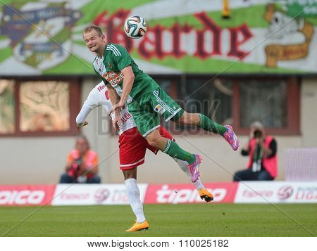 VIENNA, AUSTRIA - SEPTEMBER 28, 2014: Alan (#27 Salzburg) and Mario Sonnleitner (#6 Rapid) fight for the ball in an Austrian soccer league game.