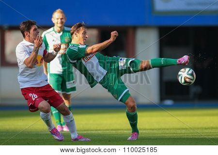 VIENNA, AUSTRIA - SEPTEMBER 28, 2014: Stefan Schwab (#8 Rapid) kicks the ball in an Austrian soccer league game.