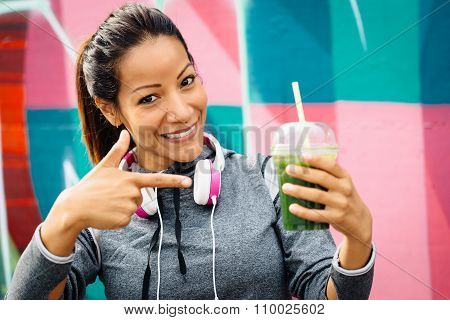 Sporty Woman Drinking Detox Smoothie