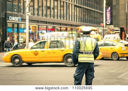 New York City - 22 December, 2013: Unidentified Nypd Officer On The Streets Of Manhattan