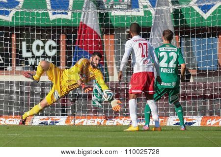 VIENNA, AUSTRIA - SEPTEMBER 28, 2014: Jan Novota (#1 Rapid) catches the ball in an Austrian soccer league game.