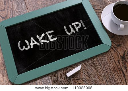 Hand Drawn Wake Up Concept on Chalkboard.