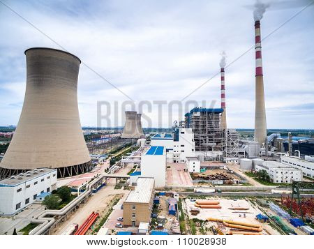 skyline, huge cooling towers and high chimneys in power plant