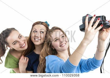 Lifestyle Concept And Ideas. Three Young Positive Smilig Caucasian Ladies Making Self Photographs Wi