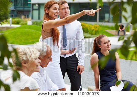 Successful woman taking leadershop for business team and showing directions