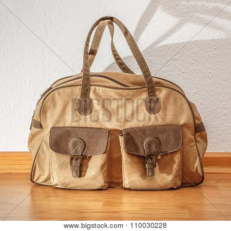 Bag On The Wooden Floor