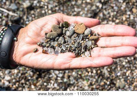 Sea glass in the hand, California