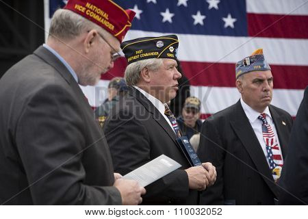 NEW YORK - NOV 25 2015: U.S. veterans attend the USS Intrepid Sea, Air & Space Museum wreath laying ceremony at Pier 86 on Veterans Day in Manhattan.