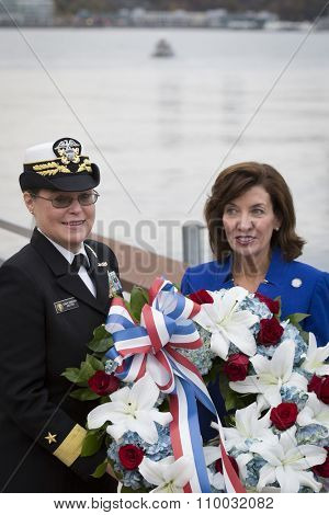 NEW YORK - NOV 25 2015: Rear Admiral Cynthia M. Thebaud, Commander, Expeditionary Strike Group 2 and Kathleen Hochul, Lt Governor of New York at the ceremony on the Intrepid Museum on Veterans Day.
