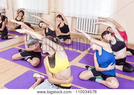 Sport And Healthy Life Concepts. Group Of Seven Young Caucasian Females Having Fitness Class In Spor