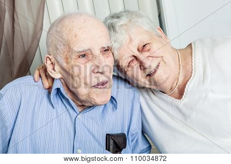 Close-up portrait of an elder couple at home