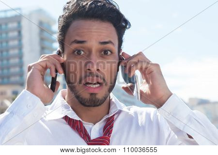 Handsome Businessman On Two Phones