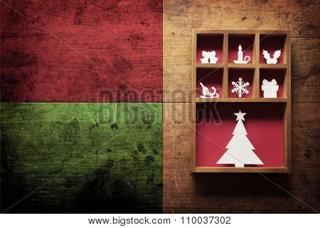 Christmas decoration on a old wooden surface, with plenty of copy space. Paper Christmas decoration (hand cut) in a wooden display tray.