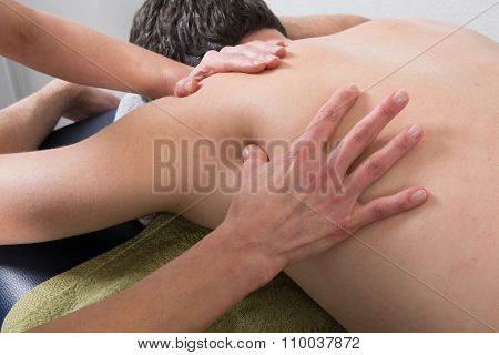 Close-up Of Person Receiving Shiatsu Treatment From Therapist
