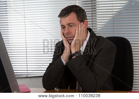 Mature Businessman Visibly Bored And Disappointed