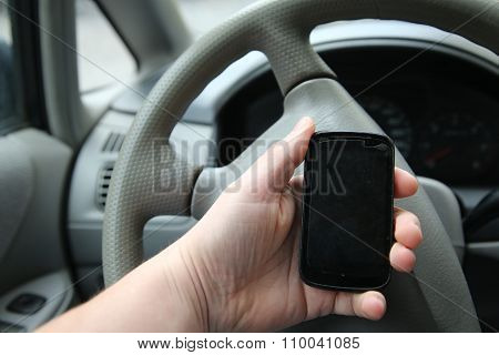Man Sitting In The Car And Holding A Touch Phone