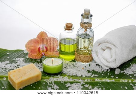 health spa with candle, orchid ,towel ,oil and banana leaf