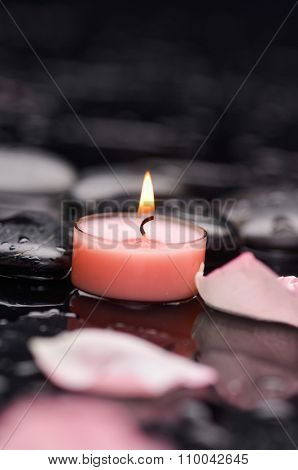 Set of Red rose petals with candle and therapy stones